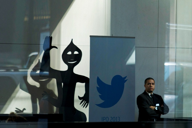 A Twitter banner is seen inside JP Morgan headquarters, before Twitter's IPO in New York, October 25, 2013.