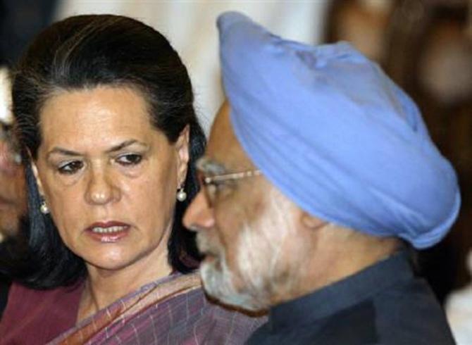 Sonia Gandhi talks to Prime Minister Manmohan Singh.