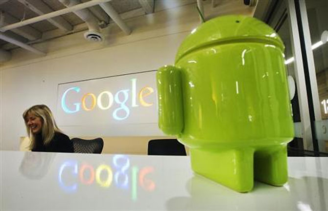 A Google Android figurine sits on the welcome desk.