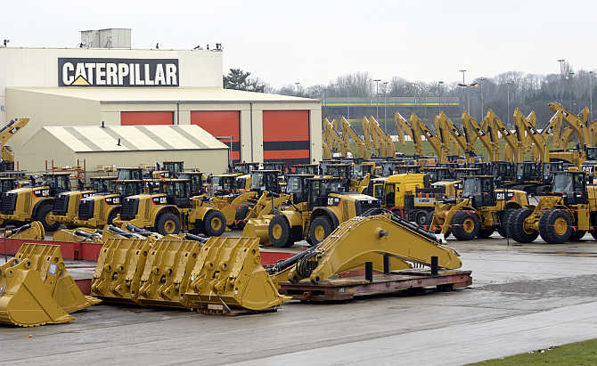 Caterpillar excavator machines are seen at a factory in Gosselies, Belgium.