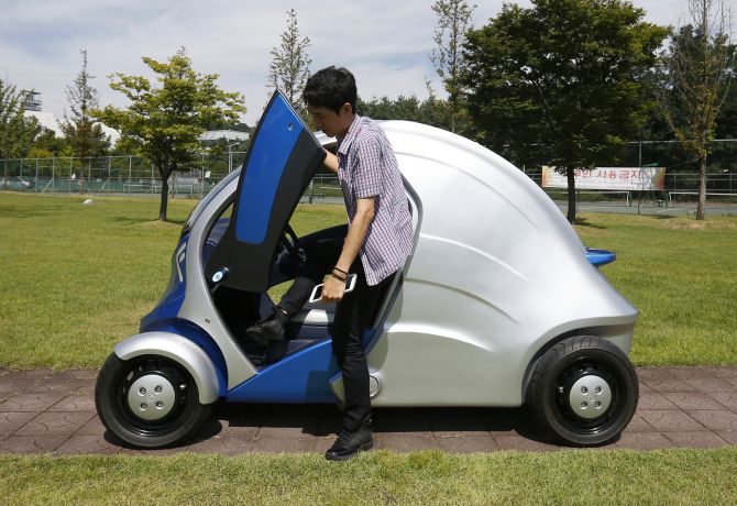 A researcher gets out of Armadillo-T, a foldable electric vehicle, at the Korea Advanced Institute of Science and Technology (KAIST) in Daejeon, south of Seoul.