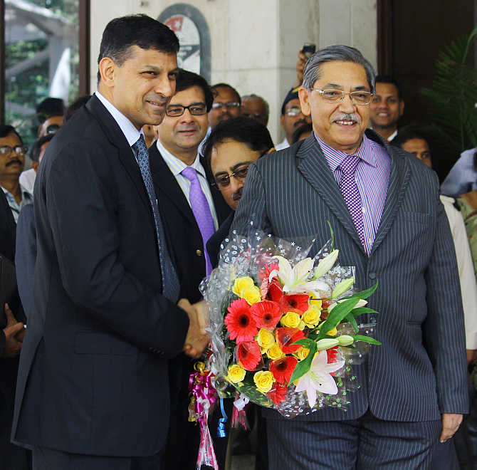 Raghuram Rajan with Deputy Governor KC Chakrabarty at RBI headquarters in Mumbai on Wednesday.