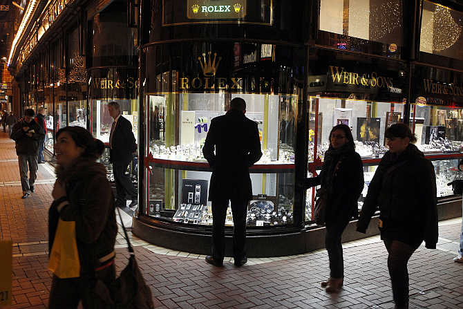 A man looks at a window display of jewellery on Grafton Street, Dublin, Ireland.