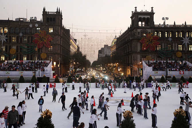 Ice skaters on an ice skating rink in Mexico City's historic Zocalo Square.