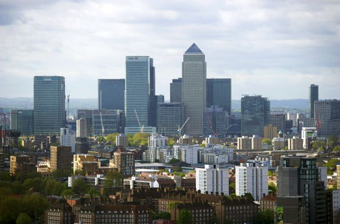 The Canary Wharf financial district is seen from the top of the ArcelorMittal Orbit in the London.