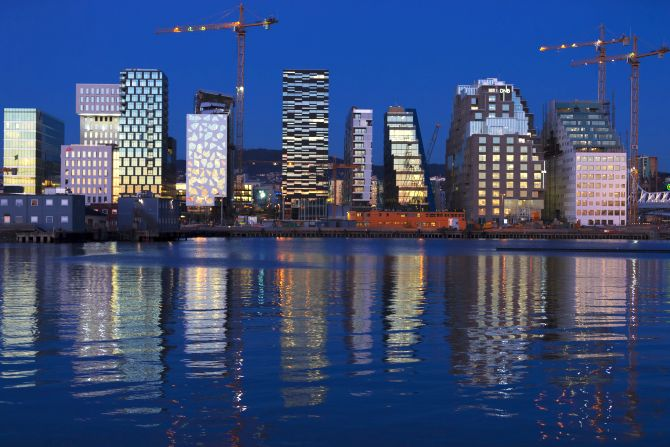 The sunset is reflected off the buildings of The Barcode Project in Oslo.