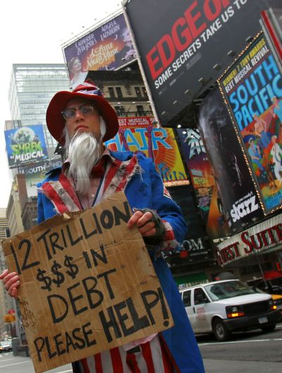 A man dressed as a destitute Uncle Sam begging for $12 trillion demonstrates in New York.