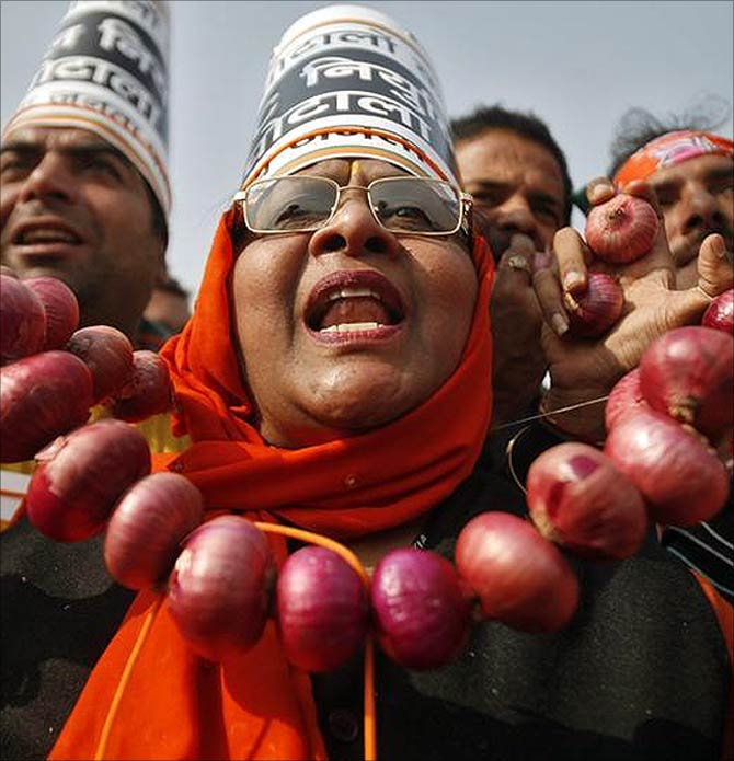 BJP activists protest against onion price rise.
