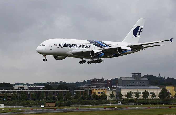 Malaysia Airlines's plane lands at the Farnborough Airshow in southern England.