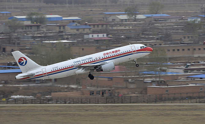 A China Eastern Airlines plane takes off at an airport in Taiyuan, Shanxi province, China.