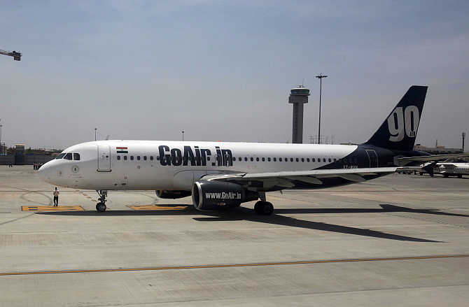 A GoAir aircraft taxis on the tarmac at Bangalore International Airport.
