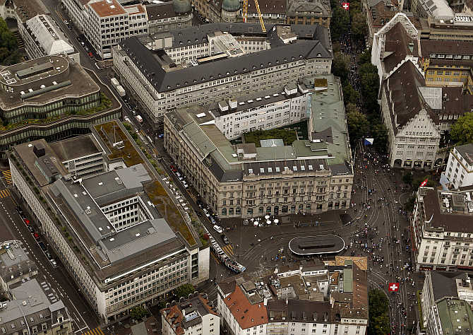 An aerial view shows the headquarters of Swiss banks UBS, front left, and Credit Suisse, centre, at the Paradeplatz square in Zurich, Switzerland.