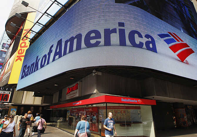 Tourists walk past a Bank of America banking centre in Times Square in New York City.