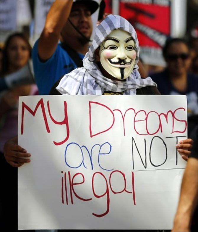 An immigration reform supporter wears a Guy Fawkes mask as he takes part in a May Day demonstation in San Diego.