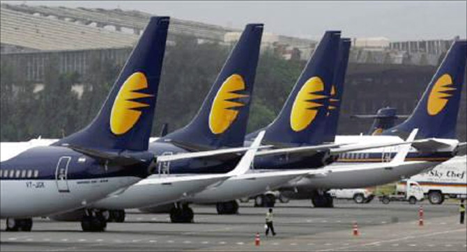 Jet Airways aircraft stand on tarmac at the domestic airport terminal in Mumbai.