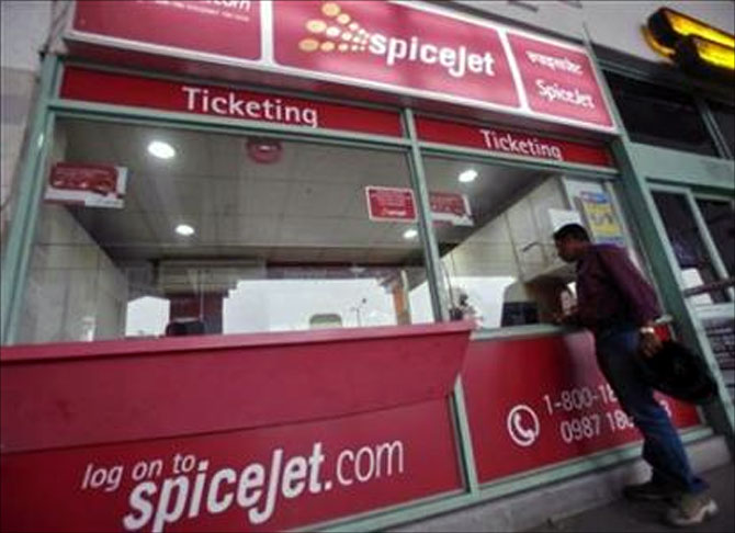 A passenger stands outside the SpiceJet Airlines ticket counter at the domestic airport on the outskirts of Agartala.