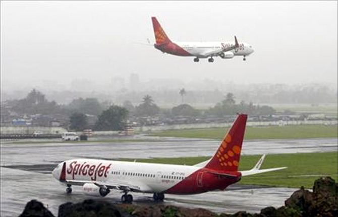 SpiceJet aircrafts prepare for landing and take-off at the airport in Mumbai
