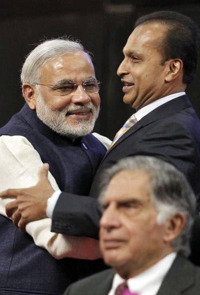 Gujarat's chief minister Narendra Modi (L) and Anil Ambani, chairman of Reliance Group, embrace as Ratan Tata, chairman Emeritus of Tata group, looks on during the inauguration ceremony of the Vibrant Gujarat global investor summit at Gandhinagar in the western Indian state of Gujarat.
