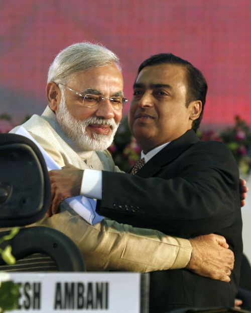 Gujarat's chief minister Narendra Modi (L) embraces Mukesh Ambani, chairman of Indian energy company Reliance Industries, during the Vibrant Gujarat Global Investors' Summit 2011 (VGGIS) at Gandhinagar in the western Indian state of Gujarat.