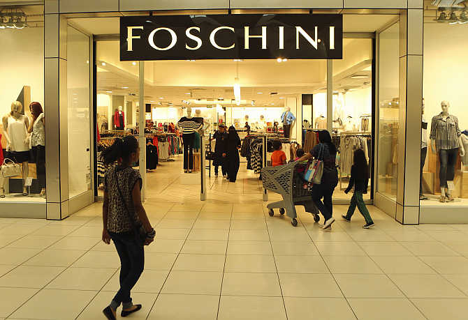 A shopper walks past a Foschini store at a shopping centre in Lenasia, south of Johannesburg.
