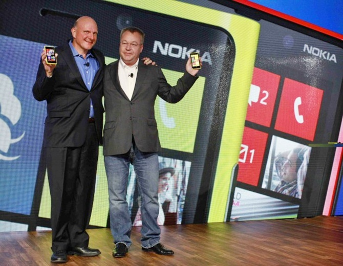 Microsoft CEO Steve Ballmer (L) and Nokia CEO Stephen Elop (R) introduce new Nokia phones with Microsoft's Windows 8 operating system at an event in New York.