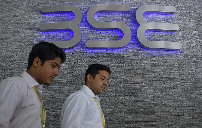 Employees walk out of the Bombay Stock Exchange building in Mumbai.