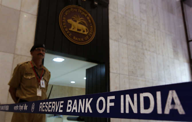 A security guard stands in the lobby of the Reserve Bank of India headquarters in Mumbai.
