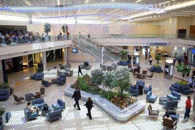 Passengers walk at the newly opened Maynard H. Jackson Jr. International Terminal at Hartsfield-Jackson Atlanta International Airport in Atlanta, Georgia.