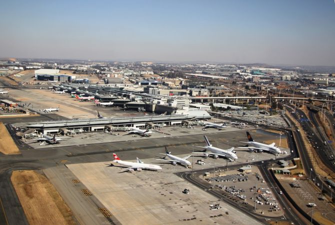 Oliver Tambo Airport surrounded by different modes of transportation and businesses - forming an Airport City.