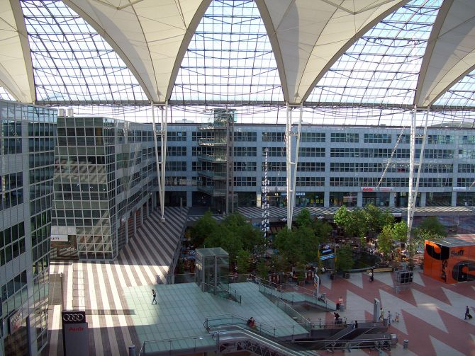 Munich Airport (MUC) Central Area with office buildings, stores and a Biergarten, located between Terminal 1 and Terminal 2.