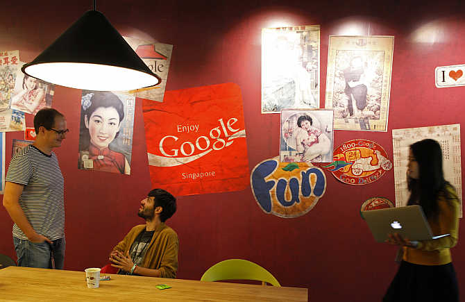 Google's employees at a pantry decorated with vintage Singapore advertisements and signages.