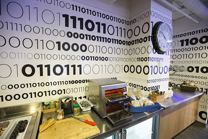 Binary code is written on the wall of the kitchen that displays Google company messages at the Google office in Toronto, Canada.