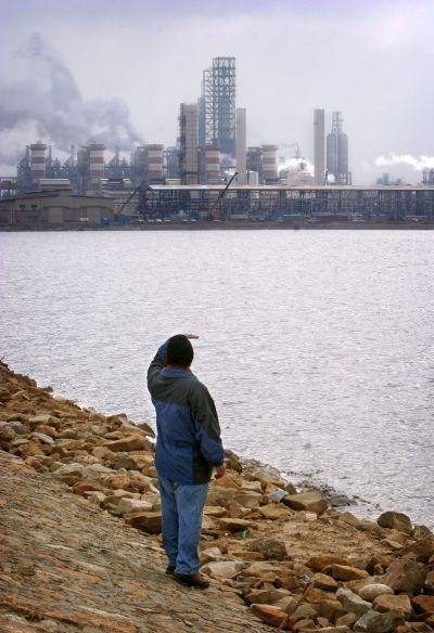 A man looks at Special Petrochemical Economic Zone.