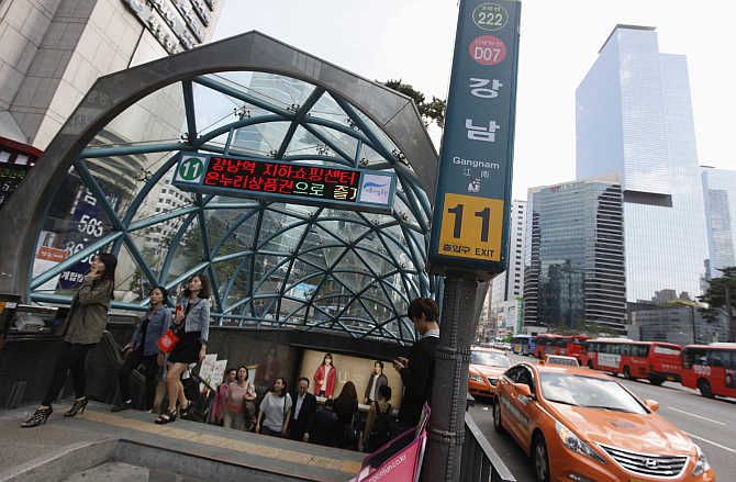 People come out at Gangnam subway station in Seoul, South Korea.