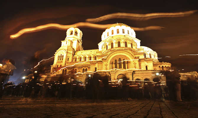 Worshippers walk around the golden-domed 'Alexander Nevski' cathedral after the Easter mass, in Sofia, Bulgaria.