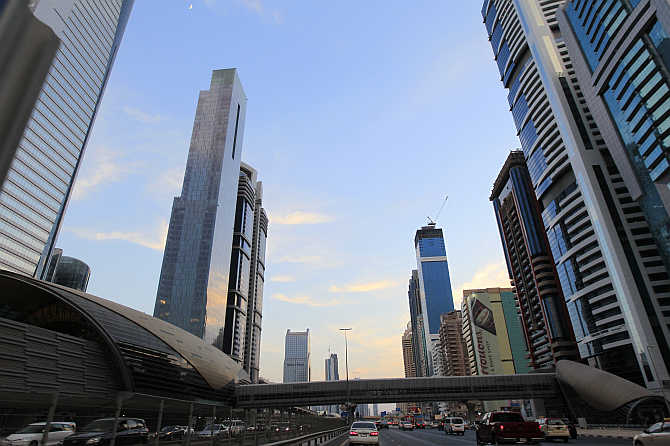 Towers are seen next to a Metro station on Sheikh Zayed Road in Dubai, United Arab Emirates.