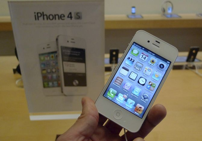 A white Apple iPhone 4S is shown on display at an Apple Store in Clarendon, Virginia.