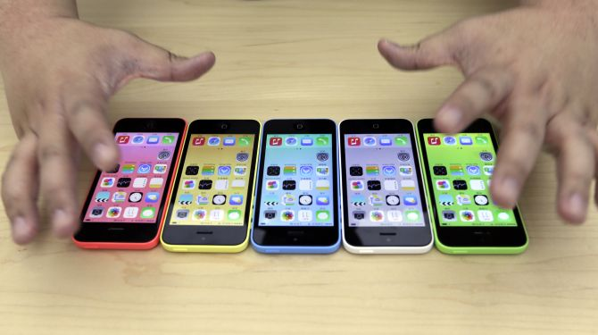 The new iPhone 5C in five colours are placed together at Apple Inc's announcement event in Beijing.