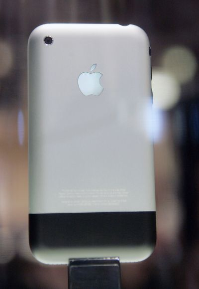 The new iPhone sits on display behind a glass case at the Macworld conference in San Francisco.