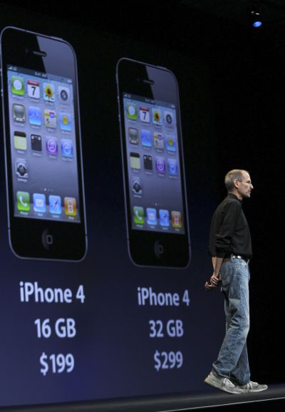 Apple CEO Steve Jobs stands in front of an image of the new iPhone 4 that explains the device's pricing, at the Apple Worldwide Developers Conference in San Francisco, California.