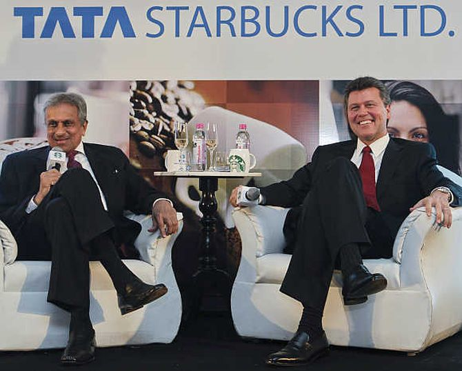 Vice-Chairman of Tata Global Beverages RK Krishna Kumar, left, and President of Starbucks China and Asia Pacific John Culver, right, in Mumbai.