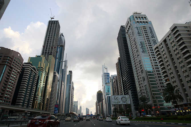 Motorists drive along Sheikh Zayed Road in Dubai, United Arab Emirates.
