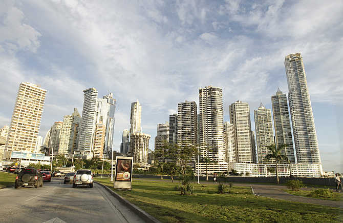 Vehicles drive on a street around the centre of Panama City, Panama.