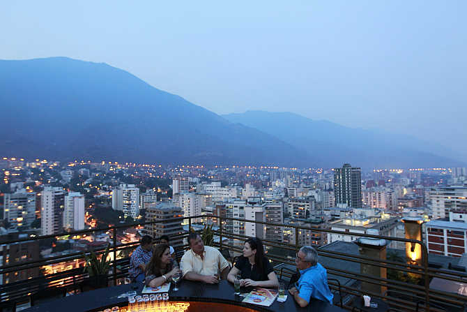 People have a drink at 360, a three-tiered rooftop bar, in Caracas, Venezuela.