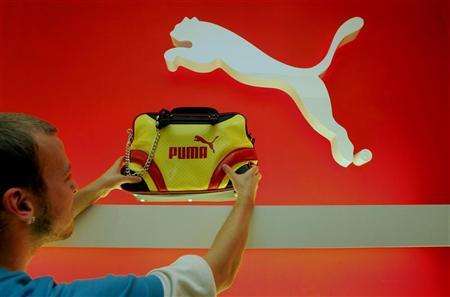 A file photo shows an employee of Germany's Puma AG arranging a handbag in a Puma shop in Munich.