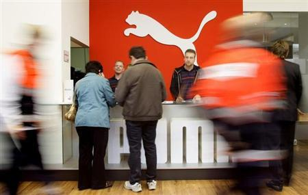 Shareholders of German sports goods firm Puma arrive for the company's annual meeting in Nuremberg.