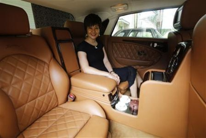 Bufori owner Tan eHong sits in her Bufori Geneva, which is fitted with a tea-making feature, at her residence in Kuala Lumpur.