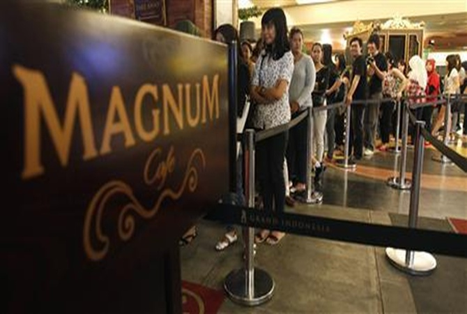 Indonesians queue to taste ice-cream in Magnum cafe in a Jakarta mall.