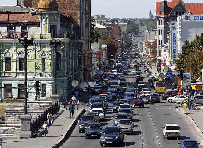 Cars move down a street in central Kharkiv, Ukraine.