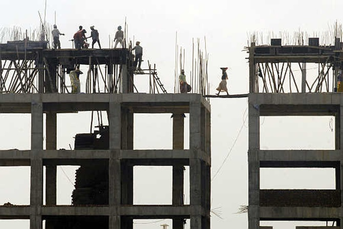 Labourers work at a construction site in Hyderabad.